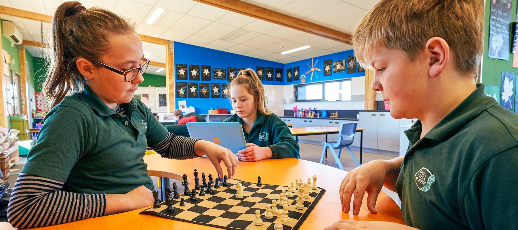 Playing chess Spring Creek School